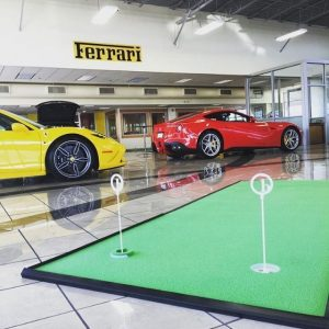 Putting green in a Ferrari Dealership for customers to work on their putting