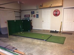 Wherever the golfer practices their putting, they can also perform a simple golf training grill, for a 4 foot to 8 foot Chip/Pitch Training Drill. Just make sure you have a backstop, like I have here in my indoor chipping/pitching facility, featured below. The backstop catches those wayward chip/pitch shots that occur from time-to-time, especially if you are rusty.