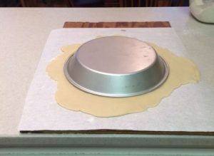 Figure No. 2 Transfer the rolled out pie dough to 9-inch deep dish pie pan.