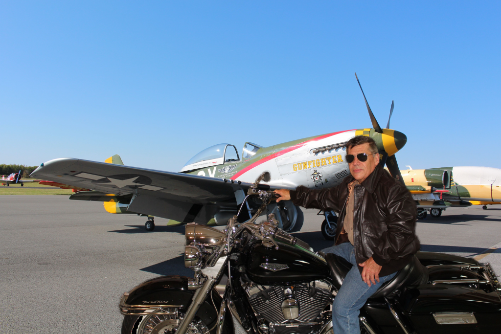 This image has an empty alt attribute; its file name is Chuck-on-a-Harley-Davidson4_InPixio-2-1024x683.png